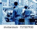 car production line  skilled... | Shutterstock . vector #717337930