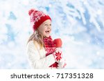 child eating candy apple on... | Shutterstock . vector #717351328