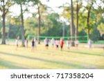 blurred group of multiethnic ... | Shutterstock . vector #717358204