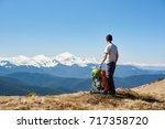 male hiker enjoying morning sun ... | Shutterstock . vector #717358720