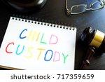 child custody written in a note ... | Shutterstock . vector #717359659