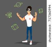 young man wearing virtual... | Shutterstock .eps vector #717360994