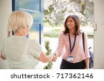 senior woman greeting female... | Shutterstock . vector #717362146
