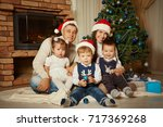 family celebrating at home.... | Shutterstock . vector #717369268