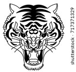 tiger head silhouette vector... | Shutterstock .eps vector #717371329