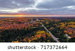 sunset over autumn foliage in... | Shutterstock . vector #717372664