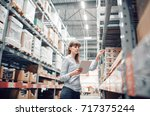 stock taking. beautiful young... | Shutterstock . vector #717375244