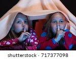 girl friends under blanket... | Shutterstock . vector #717377098