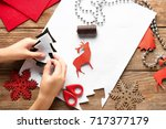 little child sewing christmas... | Shutterstock . vector #717377179