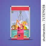 doll machine. vector flat... | Shutterstock .eps vector #717379258