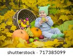 little girl in the autumn park | Shutterstock . vector #717385099