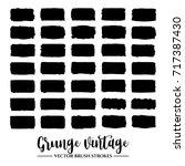 set of black brush stroke and... | Shutterstock .eps vector #717387430