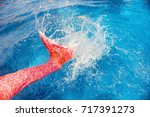 mermaid tail water splash in... | Shutterstock . vector #717391273