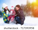attractive man  woman and child ... | Shutterstock . vector #717393958