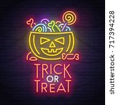 pumpkin and candy neon sign.... | Shutterstock .eps vector #717394228