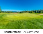 flag at the golf course. | Shutterstock . vector #717394690