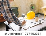 architect or construction... | Shutterstock . vector #717403384