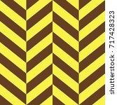 yellow and brown parallelogram... | Shutterstock .eps vector #717428323