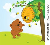 little bear and beehive. vector ... | Shutterstock .eps vector #717432700