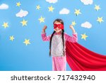 six year blonde girl dressed... | Shutterstock . vector #717432940