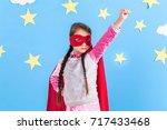 little child plays superhero.... | Shutterstock . vector #717433468