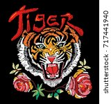 embroidery tiger with flower... | Shutterstock .eps vector #717441940