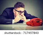 desperate man waiting for... | Shutterstock . vector #717457843