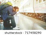 the tourist backpack man... | Shutterstock . vector #717458290