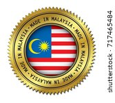 made in malaysia golden badge... | Shutterstock .eps vector #717465484