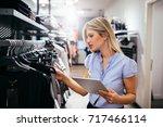 young woman using digital... | Shutterstock . vector #717466114