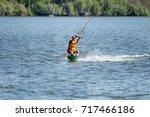 kiteboarding. wake park....   Shutterstock . vector #717466186