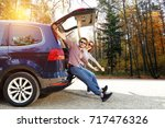 autumn trip of car and two... | Shutterstock . vector #717476326