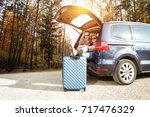 autumn trip of car and two... | Shutterstock . vector #717476329