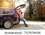 autumn trip of car and two...   Shutterstock . vector #717476434