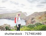 young blonde woman traveler... | Shutterstock . vector #717481480