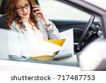 attractive female sales manager ... | Shutterstock . vector #717487753