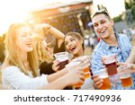 friends drinking beer and...   Shutterstock . vector #717490936