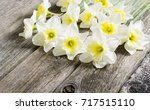 white daffodil flowers on old... | Shutterstock . vector #717515110