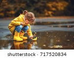 happy child girl with umbrella...   Shutterstock . vector #717520834