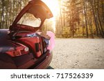 autumn sunset time and car on... | Shutterstock . vector #717526339