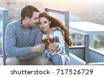 man and woman with glass of... | Shutterstock . vector #717526729