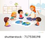 children sit around world map... | Shutterstock . vector #717538198