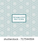 seamless pattern with simple... | Shutterstock .eps vector #717544504