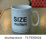 this is one very large cup for... | Shutterstock . vector #717550426