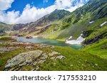 mountain lake. the lake between ...   Shutterstock . vector #717553210