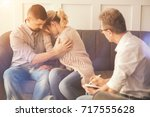 unhappy nice man hugging his... | Shutterstock . vector #717555628