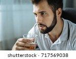 depressed good looking man... | Shutterstock . vector #717569038
