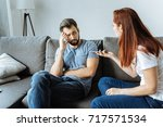 unhappy angry woman talking to... | Shutterstock . vector #717571534