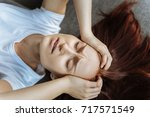 sad cheerless woman closing her ... | Shutterstock . vector #717571549