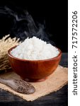 cooked rice with smoke in... | Shutterstock . vector #717572206